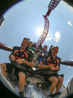 Jamie Whincup and Sébastien Bourdais ride the BuzzSaw roller coaster at Dreamworld