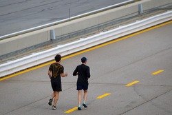 Kuno Wittmer and Dominik Farnbacher jog pitlane