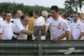 Team members of San Carlo Gresini Honda pay tribute to Marco Simoncelli