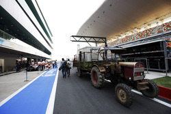 Tractor beside the Sahara Force India F1 VJM05 in the pits