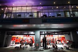Ferrari pit garage at night