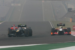 Vitaly Petrov, Caterham leads Pedro De La Rosa, HRT Formula 1 Team