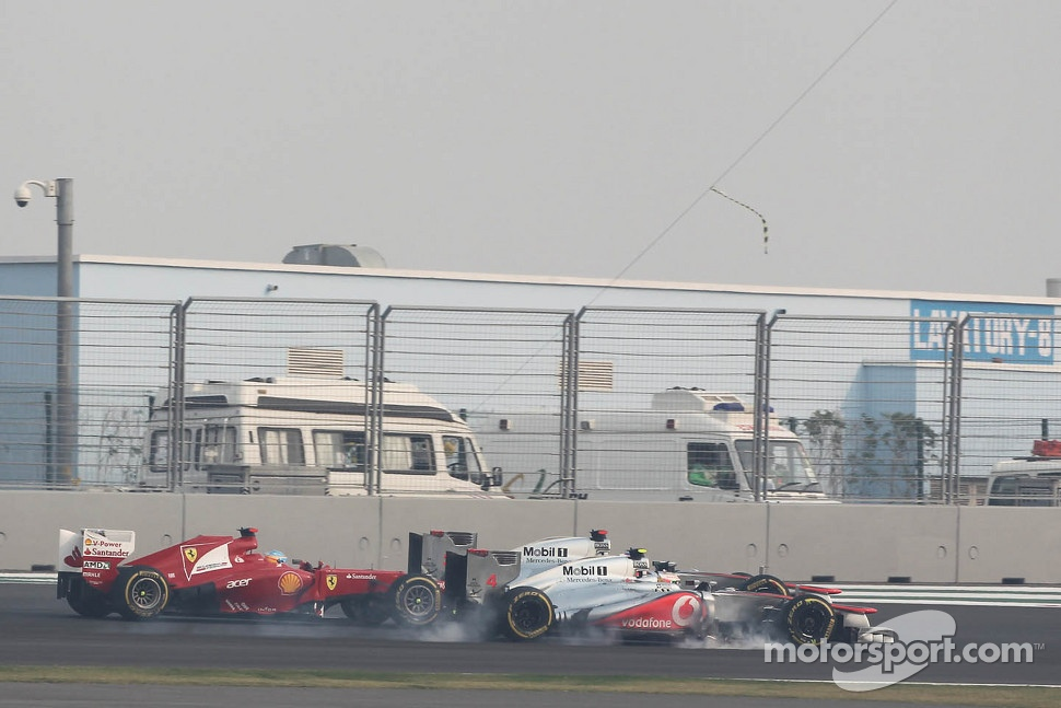 Lewis Hamilton, McLaren, Jenson Button, McLaren and Fernando Alonso, Ferrari battle for position