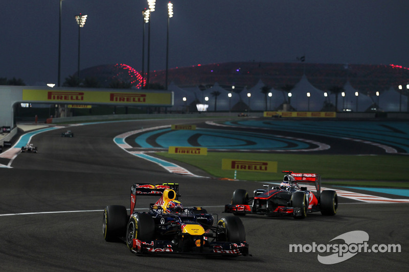 Mark Webber, Red Bull Racing leads Jenson Button, McLaren