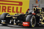 Race winner Kimi Raikkonen, Lotus F1 celebrates at the end of the race