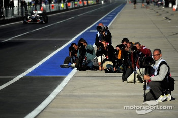 Photographers on pitlane