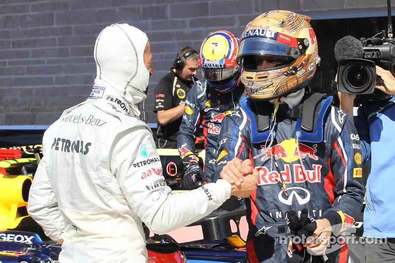 Michael Schumacher, Mercedes AMG Petronas and pole for Sebastian Vettel, Red Bull Racing
