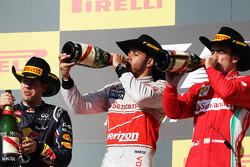 The podium: Sebastian Vettel Red Bull Racing, second; Lewis Hamilton, McLaren, race winner; Fernando Alonso, Ferrari, third