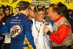 Championship victory lane: 2012 NASCAR Sprint Cup Series champion Brad Keselowski, Penske Racing Dodge celebrates with his dad and Roger Penske