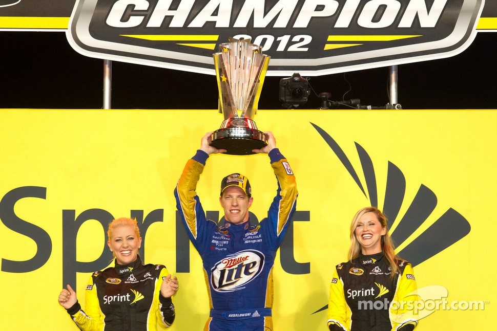 Championship victory lane: 2012 NASCAR Sprint Cup Series champion Brad Keselowski, Penske Racing Dodge celebrates with the Miss Sprint Cup girls