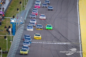 Brian Scott, Joe Gibbs Racing Toyota leads a group of cars