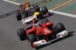 Fernando Alonso, Scuderia Ferrari leads Sebastian Vettel, Red Bull Racing