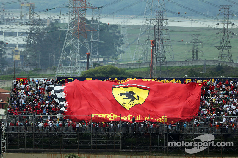 Large Ferrari banner with the fans in the grandstand
