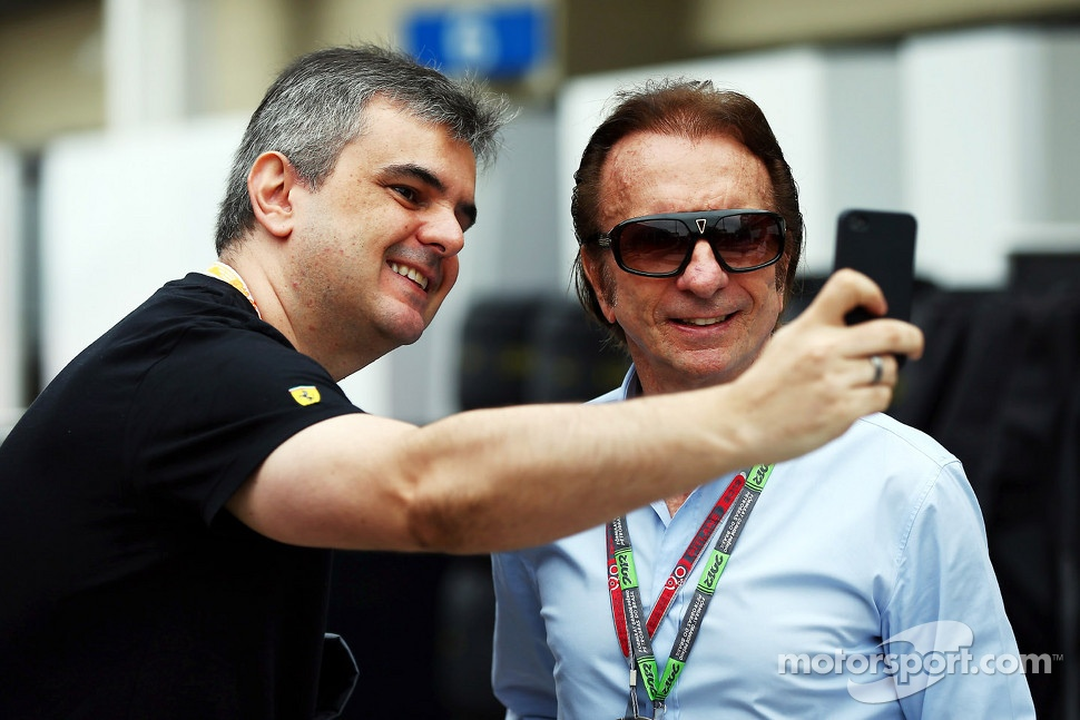 Emerson Fittipaldi, with a fan