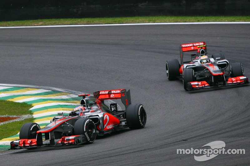 Jenson Button, McLaren leads team mate Lewis Hamilton, McLaren