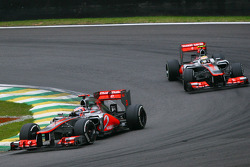 Jenson Button, McLaren leads team mate Lewis Hamilton, McLaren