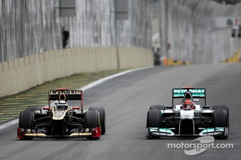 Kimi Raikkonen, Lotus F1 Team and Michael Schumacher, Mercedes GP