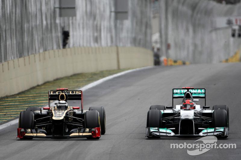 Kimi Räikkönen, Lotus F1 Team, und Michael Schumacher, Mercedes GP