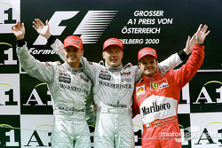 Podium: race winner Mika Hakkinen, second place David Coulthard, third place Rubens Barrichello