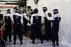 Williams mechanics warm up routine before practicing pit stops