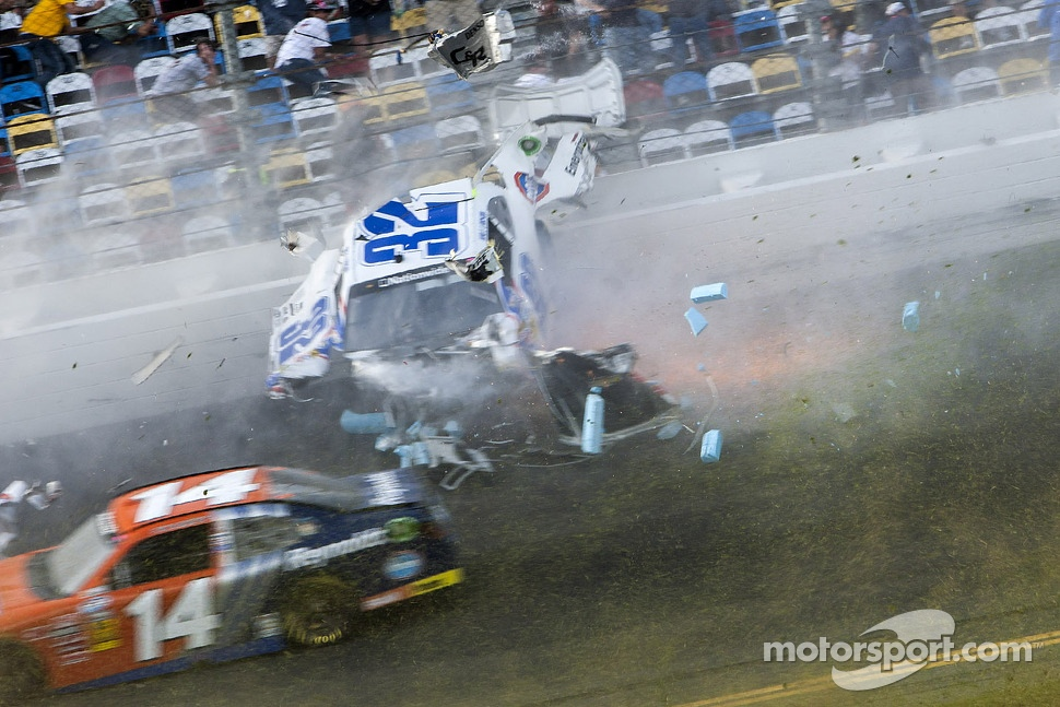 Last lap crash: Kyle Larson hits the catch fence as Eric McClure goes by