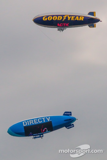 Two blimps meet in the sky during the race
