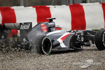 Nico Hulkenberg, Sauber C32 runs wide through the gravel trap