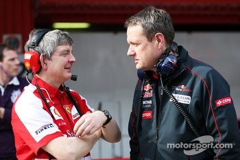 Steve Clark, Ferrari Chief Engineer with Steve Nielsen, Scuderia Toro Rosso Sporting Director