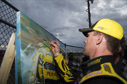 Victory lane: race winner Carl Edwards, Roush Fenway Racing Ford signs a work of art