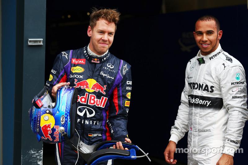 Pole sitter Sebastian Vettel, Red Bull Racing in parc ferme with Lewis Hamilton, Mercedes AMG F1