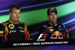 (L to R): Kimi Raikkonen, Lotus F1 Team and Sebastian Vettel, Red Bull Racing in the FIA Press Conference