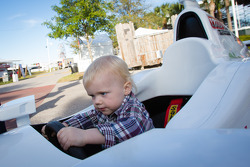 Dan Wheldon Memorial and Victory Circle unveiling ceremony: Oliver Wheldon has fun in an IndyCar