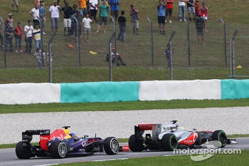 Sergio Perez, McLaren MP4-28 leads Sebastian Vettel, Red Bull Racing RB9