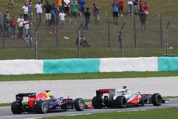 Sergio Perez, McLaren MP4-28 leads Sebastian Vettel, Red Bull Racing RB9