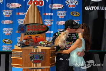 Victory lane: race winner Kyle Busch and Samantha Busch