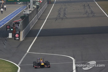 Mark Webber, Red Bull Racing RB9 leaves the pits at the start of lap 2