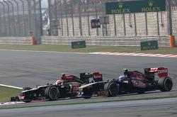 Romain Grosjean, Lotus F1 Team and Jean-Eric Vergne, Scuderia Toro Rosso