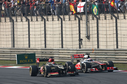 Kimi Raikkonen, Lotus F1 Team and Jenson Button, McLaren Mercedes