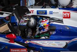 Sebastien Buemi getting strapped in the #8 Toyota