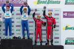 Overall podium: winners Scott Pruett and Memo Rojas, third place Jon Fogarty, Alex Gurney