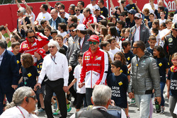 (L to R): Bernie Ecclestone, CEO Formula One Group, with Fernando Alonso, Ferrari and Lewis Hamilton, Mercedes AMG F1 at a FIA Safe Roads display with F1 personnel