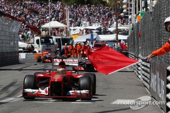Fernando Alonso, Ferrari F138 passes red flags as the race is stopped