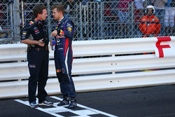 Sebastian Vettel, Red Bull Racing with Christian Horner, Red Bull Racing Team Principal on the grid as the race is stopped