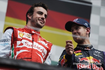 The podium: Fernando Alonso, Ferrari, second; Sebastian Vettel, Red Bull Racing, race winner