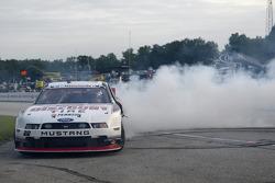 Race winner A.J. Allmendinger celebrates