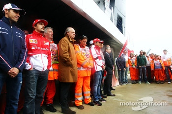 Drivers, marshals, and Jean Todt, FIA President pay their respects to Mark Robinson, the marshal tragically killed at the Canadian GP