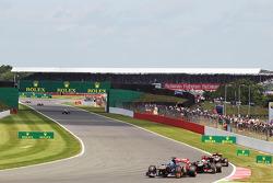 Jean-Eric Vergne Scuderia Toro Rosso STR8 leads Romain Grosjean Lotus F1 E21 and Kimi Raikkonen Lotus F1 E21