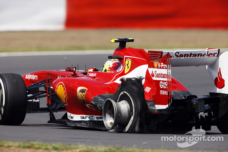 Felipe Massa Ferrari F138 with a rear Pirelli tyre puncture
