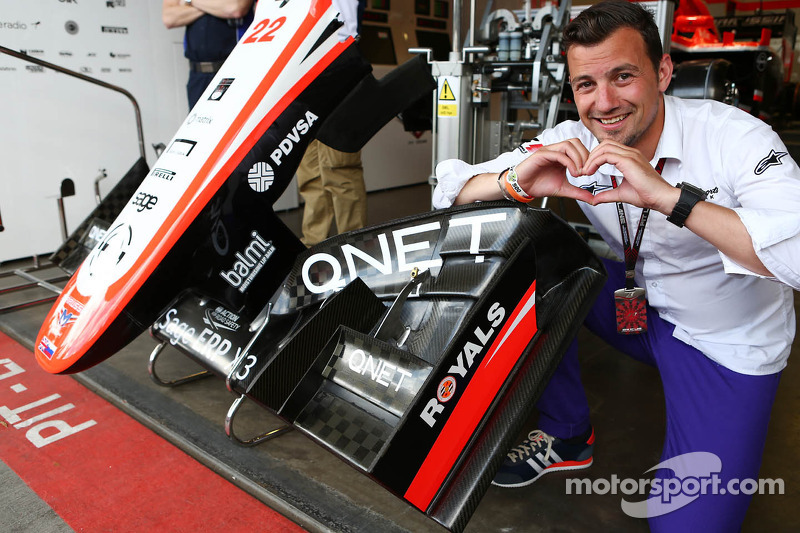 Will Buxton, NBS Sports Network TV Presenter enjoys the Reading FC branding on the Marussia F1 Team MR02 nosecone