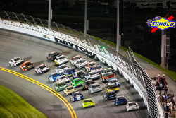 Jimmie Johnson, Hendrick Motorsports Chevrolet leads the field in the last lap while Casey Mears, Germain Racing Ford and Carl Edwards, Roush Fenway Racing Ford get loose at the back
